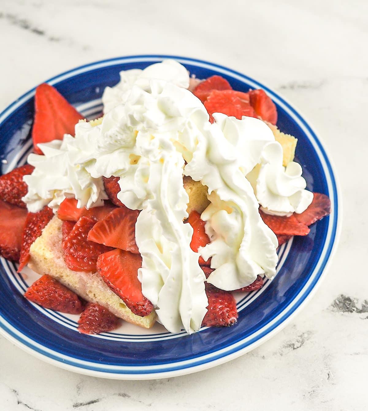 strawberry shortcake on blue rimmed plate