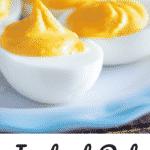 deviled eggs on blue edged plate