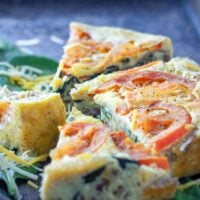 cut frittata pieces on a cookie sheet