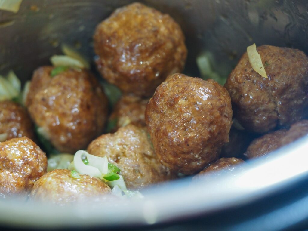 meatballs in instant pot with diced cooked vegetables