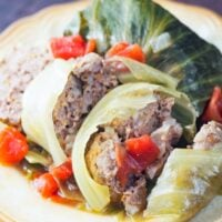 close up view of sliced cabbage roll on yellow plate