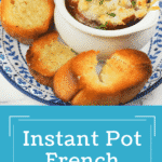 french onion soup in crock on white plate with blue floral trim