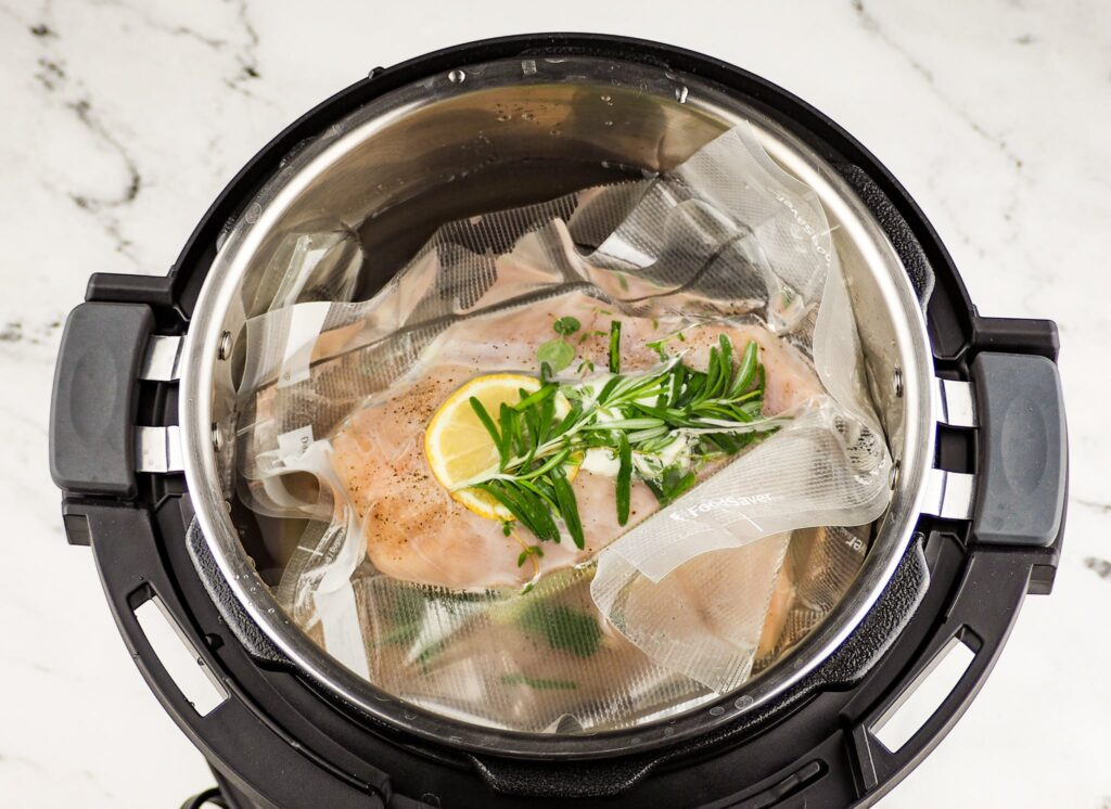 overhead view of bagged lemon chicken in instant pot sous vide