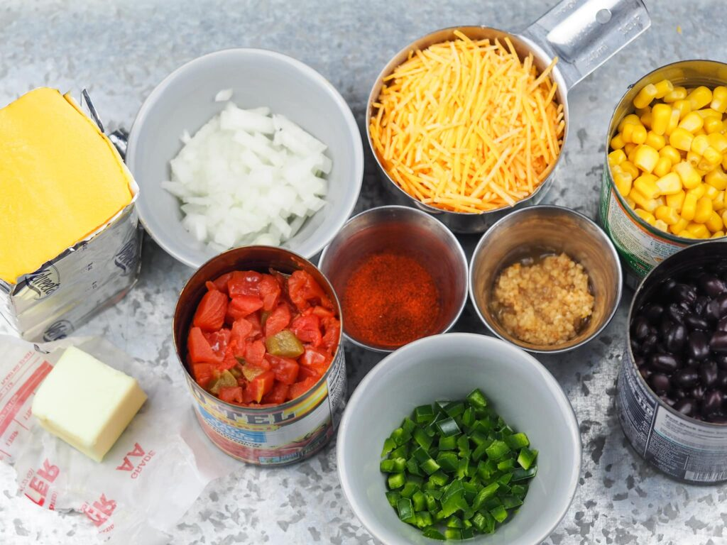 ingredients for queso dip arranged on tray for easy reference