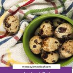 quail eggs in green bowl with multi colored towel
