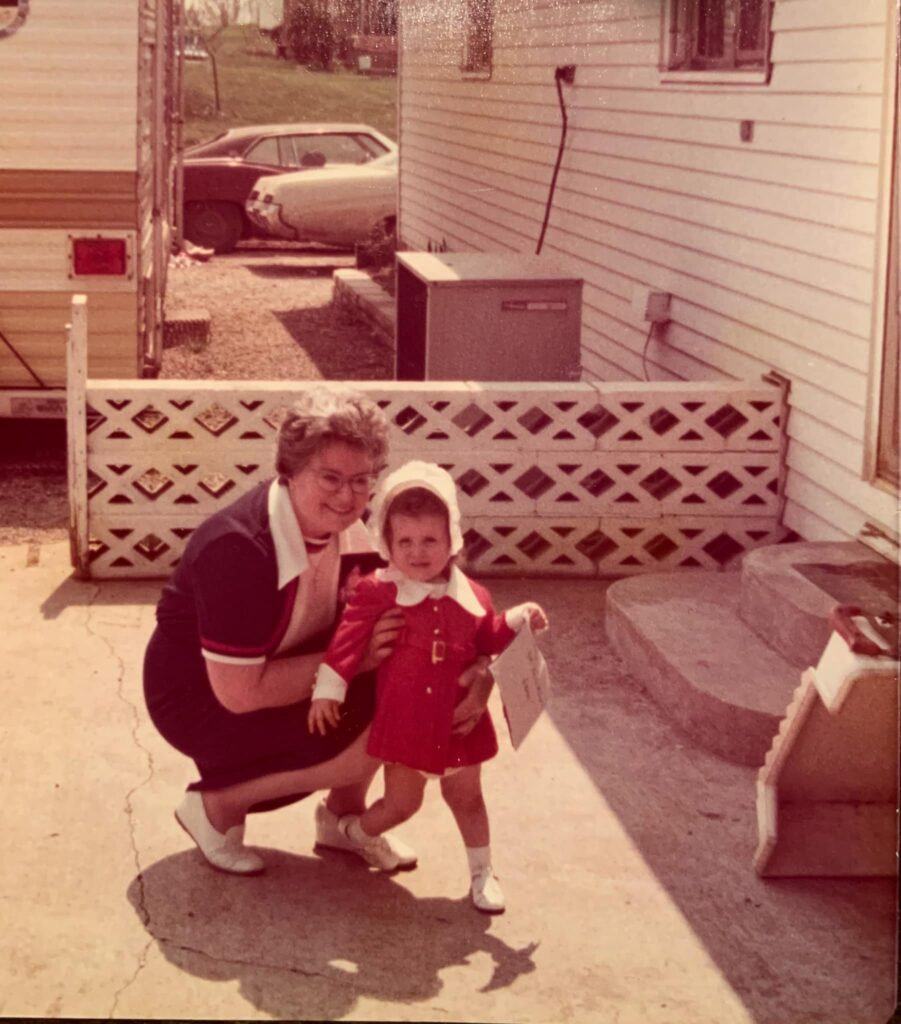 grandma marie with tina as a toddler on back concrete porch