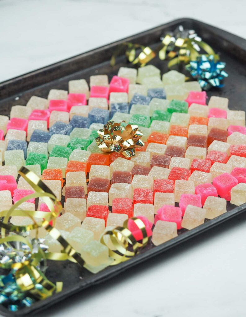 hard tack candy arranged in a mosaic pattern on baking sheet