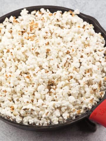 popcorn in cast iron pan