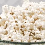 popcorn in green glass bowl