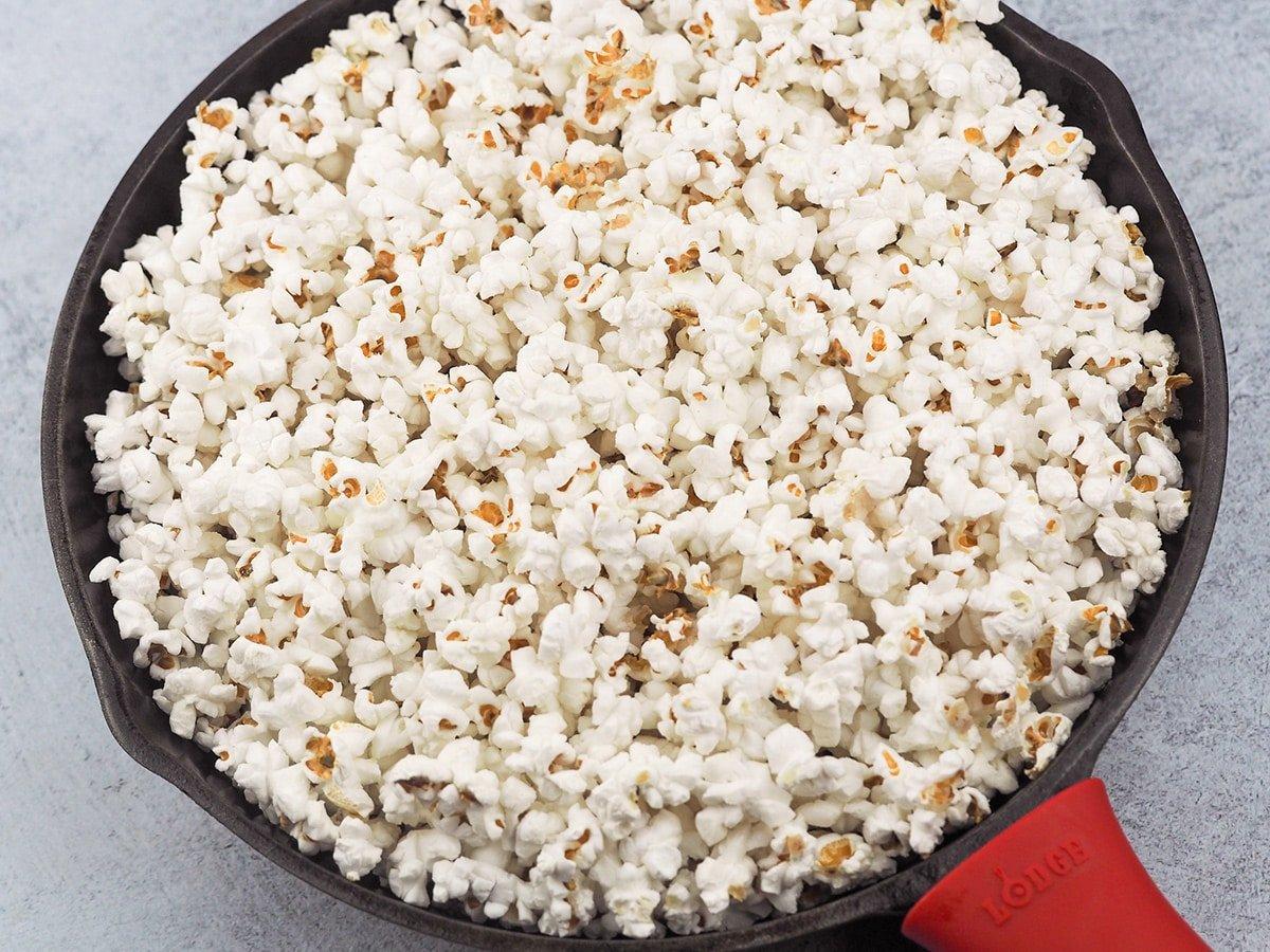 popped popcorn in cast iron skillet
