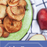 air fryer apple chips on green plate with linen towel